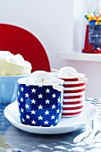 Cocoa with marashmallows in stars and stripes mugs