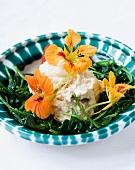 Smoked fish cream with baby spinach and nasturtium flowers