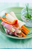 Cheese and ham rolls with vegetable sticks