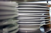 A stack of plates in a commercial kitchen