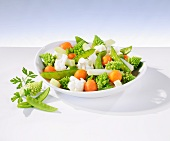Mixed vegetables with Romanesco broccoli, cooked and fresh