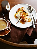 Fried pears with caramel sauce and a cup of coffee