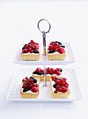 White chocolate tarts with berries on a cake stand