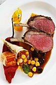 Saddle of lamb with an olive crust, chickpeas and a pepper medley