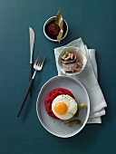 Lobscouse made from marinated beef brisket with sweet and sour herring and a fried egg