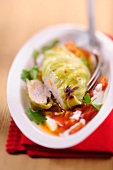 Cabbage roulade on tomato sauce