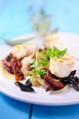 Monkfish medallions with onion confit, olives and dried tomatoes