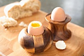 Soft-boiled eggs in wooden egg cups