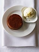 Chocolate cake with ice cream and pistachios