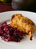 Goose leg with red cabbage