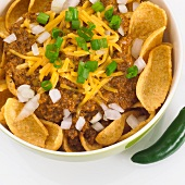 Bowl of Chili with Frito Corn Chips, Shredded Cheese and Onions