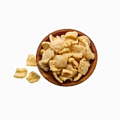 Fried Pork Rinds in a Bowl on a White Background; From Above