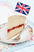 A slice of sponge cake with a small flag