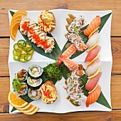 Sushi and Sashimi Sampler Platter; Tuna, Whitefish, Salmon, Shrimp, Tempura Shrimp and Avocado Rolls Wrapped in Seaweed