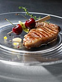 Grilled veal steak with cherries