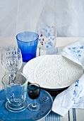 Various drinking glasses and plates