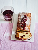 A loaf cake with cranberries, sliced