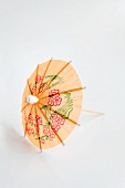 An orange cocktail umbrella