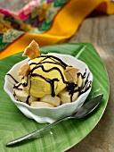Mango ice cream with banana and chocolate sauce