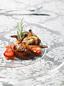 Roasted quail with strawberries and rosemary