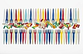 Rows of colourful pills and plastic forks