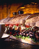 A Large Sub Sandwich with a Steaming Cup
