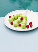 Melon kebabs with raspberries