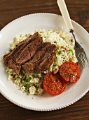 Lamb with coucous and tomatoes (Morocco)