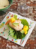 Prawns with avocado and melon wrapped in lettuce leaves