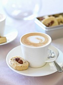 A cappuccino with walnut shortbread