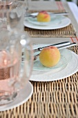 Place settings with fresh peaches