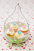 Four cupcakes in a white metal basket