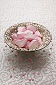 Heart-shaped marshmallows in a silver dish
