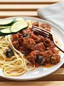 Lamb ragout with olives and tagliatelle