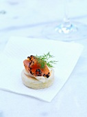 A sponge cake canape topped with smoked salmon