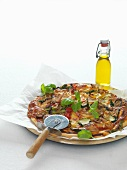 A grilled vegetable pizza and onions
