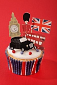 A cupcake decorated with London icons