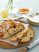 Sliced soda bread with raisins on a wooden board