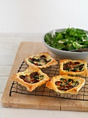 Puff pastry tartlets with spinach and chorizo