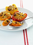 Peppers filled with couscous, pine nuts and raisins