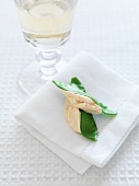 Salmon cream on mange tout with a glass of white wine