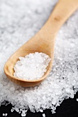 Coarse salt with a wooden spoon