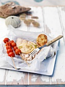 Grilled fish with tomato kebabs