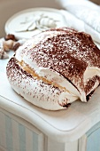 A Meringue Cookie Dusted with Cocoa Powder