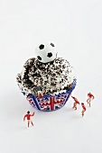 A cupcake with cream and football decoration (Great Britain)