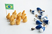 Salgadinhos with a Brazilian flag and football decorations
