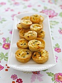 Mini tartlets with caramelised onions and feta cheese