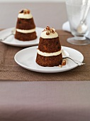Small carrot and pineapple cakes with cream and pine nuts