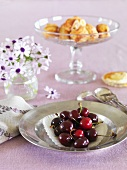 Fresh cherries on a silver plate