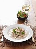 Boeuf stroganoff on a bed of rice with a glass of white wine